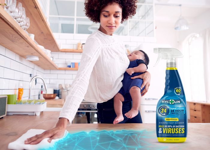 woman cleaning with baby